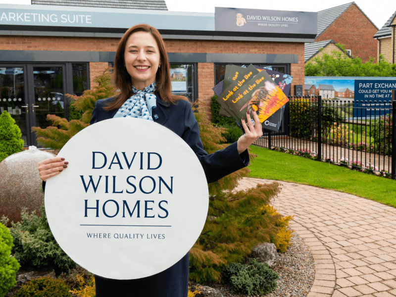 Bethany Austin Sales Adviser at David Wilson Homes holding the Bee Books