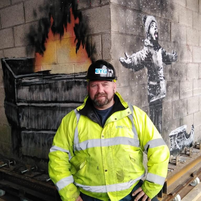 Andy Coles of EYG next to the Banksy art installation