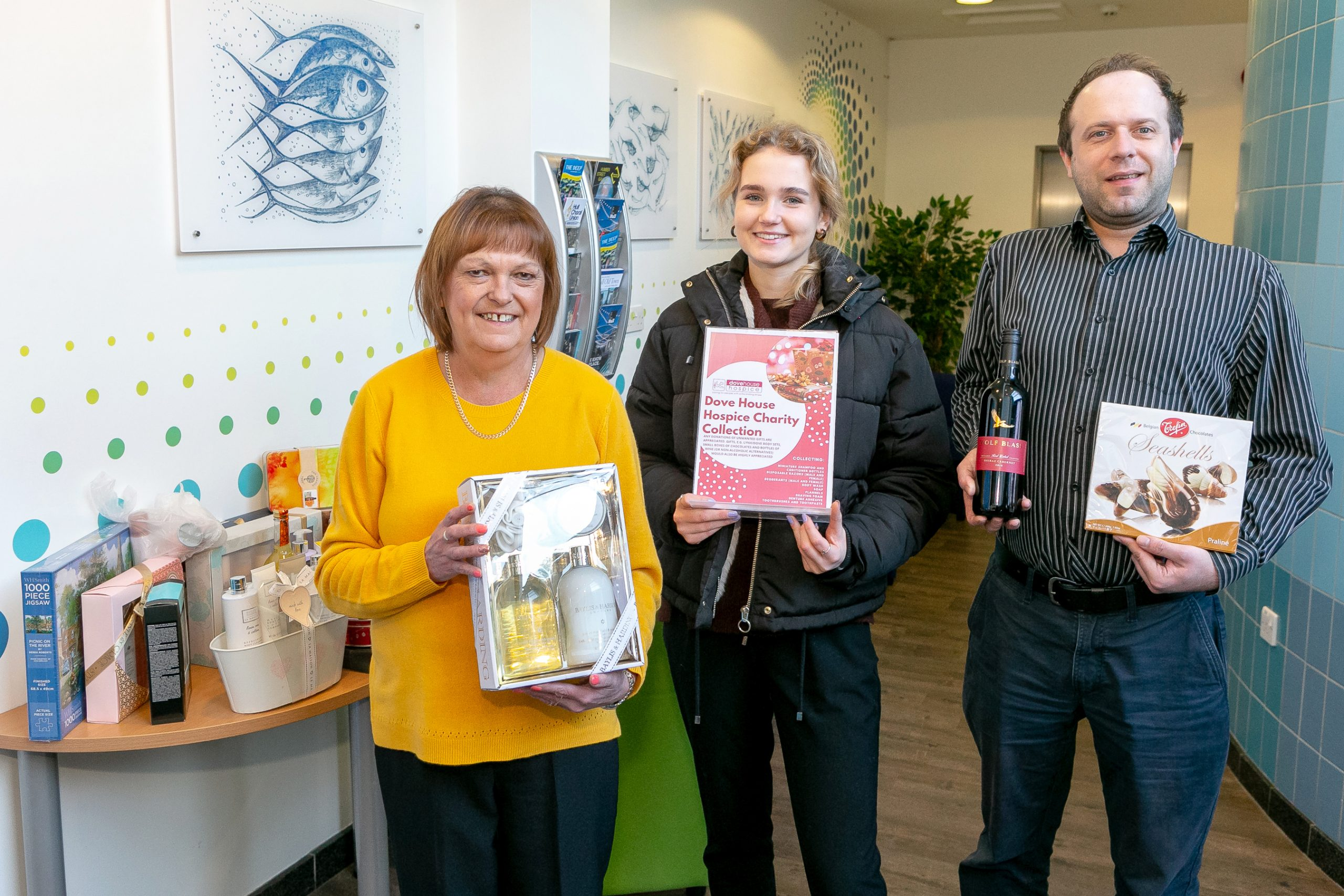 Pictured with some of the items collected at The Deep Business Centre are (from left) receptionist Sue Waterhouse, Business Centre visitor Megan Jaram and James Slingsby, who works in the Business Centre for Denholm Port Services.