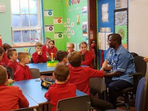 Justin Mwange talks to pupils