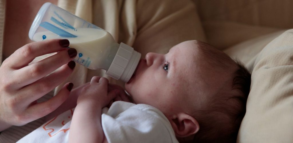 Infant with bottle.
