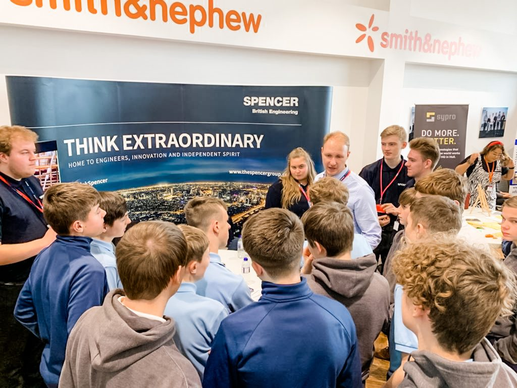 Spencer Group Engineer Thomas Inglis speaking with Ron Dearing UTC students at the Apprenticeships Expo.