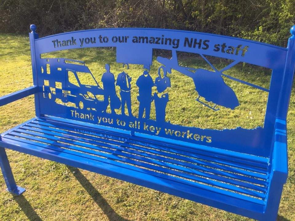 A bench displays a message of thanks to hospital staff.