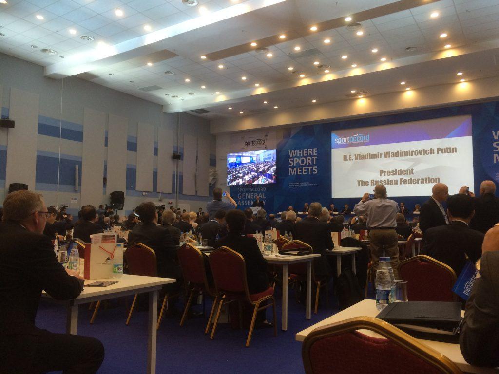 Vladimir Putin – you can just spot him in the corner – speaking in Sochi.