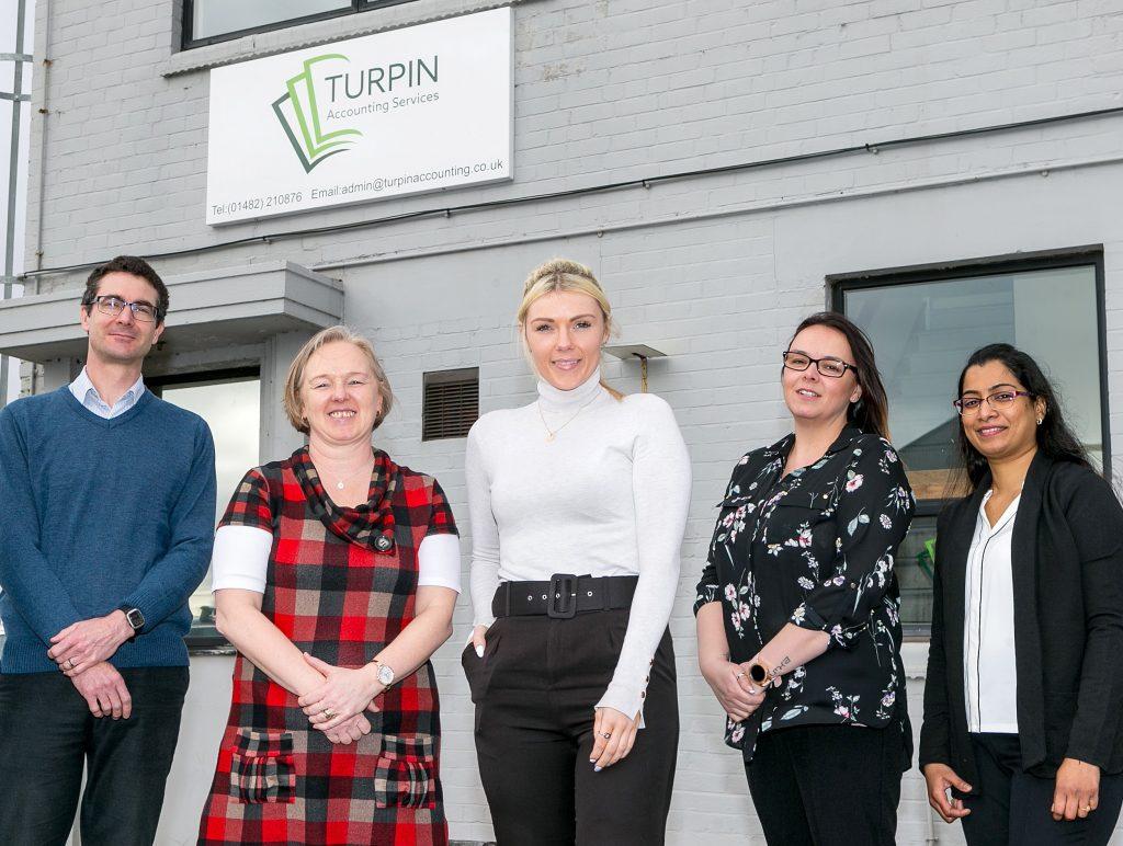 The Turpin Accounting Services team (from left) Ian Paradine, Liz Turpin, Bel Turpin, Lisa Palmer and Deepika Mongolu.