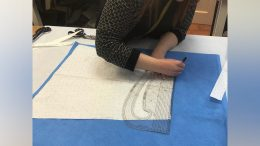 Gill working on the fabric which her team is using to make PPE for Hull Royal Infirmary.