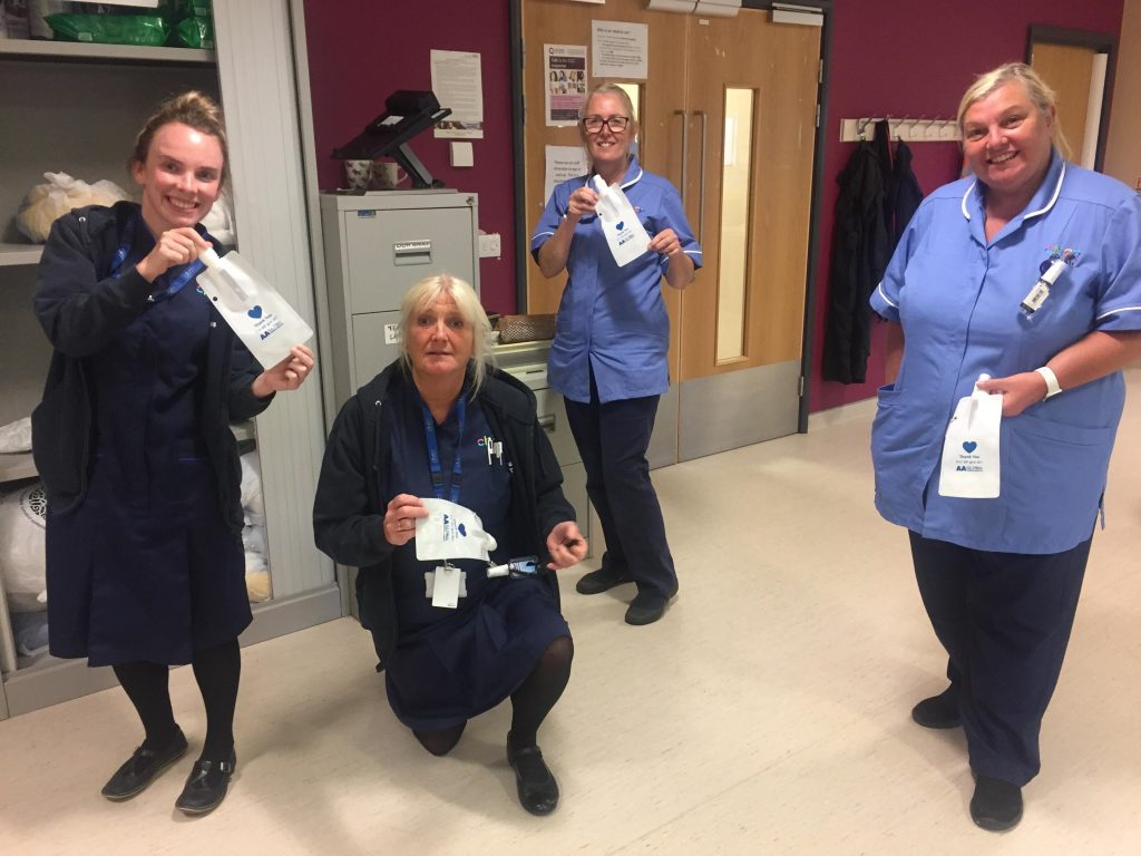 NHS frontline staff receiving bottles donated by AA Global Language Services
