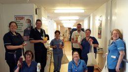 Staff receiving welfare packs