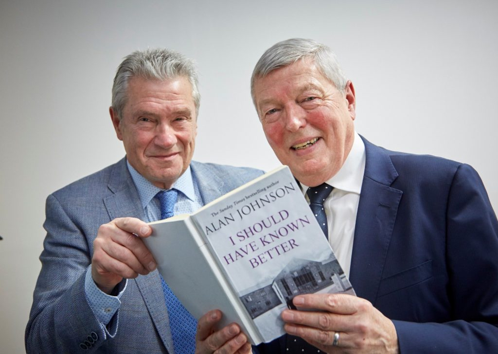 Paul Sewell presenting Alan Johnson with a mock-up book