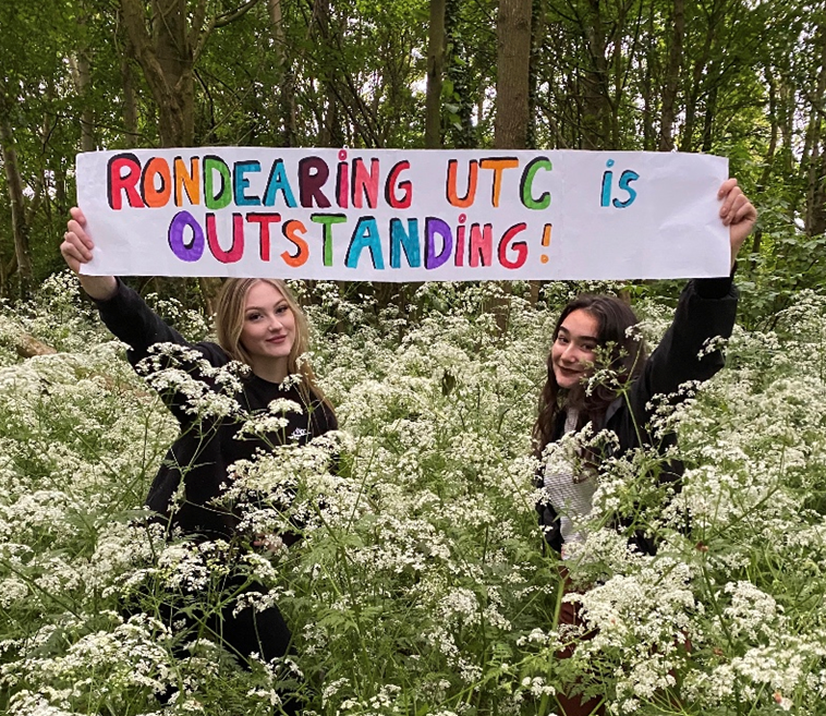 Year 12 students Ryah Russell and Natalie Bamforth celebrate Ron Dearing UTC's Outstanding Ofsted grade in the great outdoors.