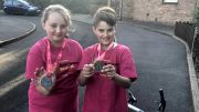 Lottie & Riley with medals