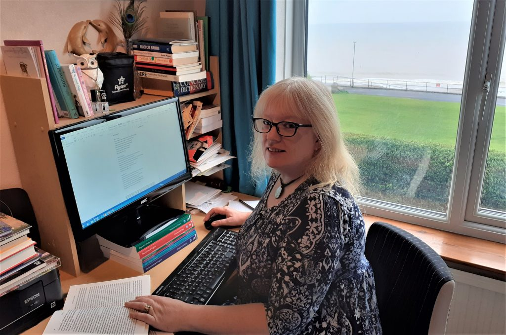 Alison Riley at her desk overlooking the North Sea in Hornsea.