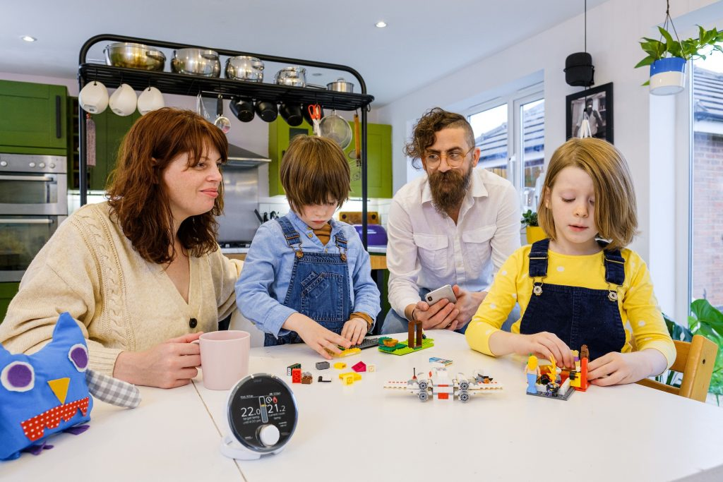 Jim Wardlaw, Chief of Product and Design at Sauce, and his family at home with the Halo Combi Wi-Fi heating system.