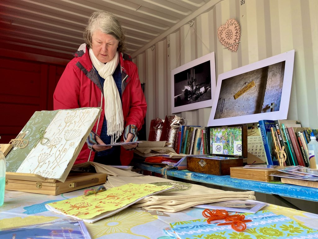 Fiona Caley, artist in residence at Rooted in Hull, inside her 'big red box' studio.