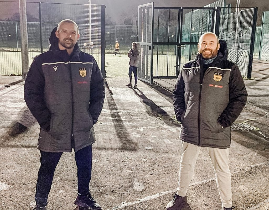 Coaches Paul Richardson and Ryan Clarkson wearing winter jackets funded under the new sponsorship from Beal Homes.