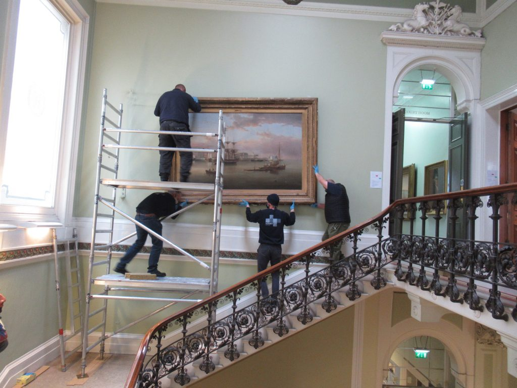 The two large paintings have been removed from the museum's main stairwell walls using specialist equipment.