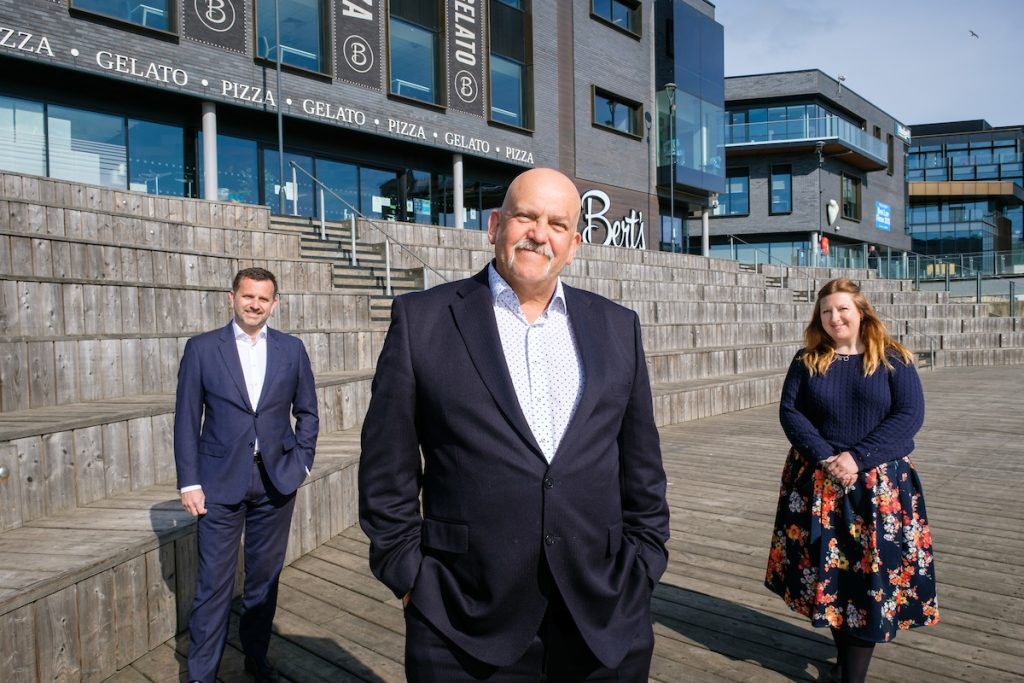 Playwright John Godber, centre, with Wykeland Group Managing Director Dominic Gibbons and Natalia Cleary, Events Co-ordinator for Stage @TheDock. The John Godber Company, supported by Wykeland and Arts Council England, is bringing live outdoor theatre back to Hull.