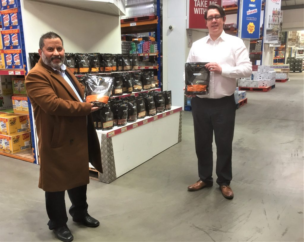 Mukesh Tirkoti (left) of Tapasya Spices and Mark Pattison, Cash and Carry Manager at Dee Bee Wholesale at the company's Hull warehouse.